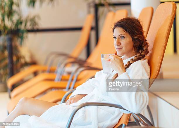 Healthy woman enjoys relaxing day at spa centre in swimsuit