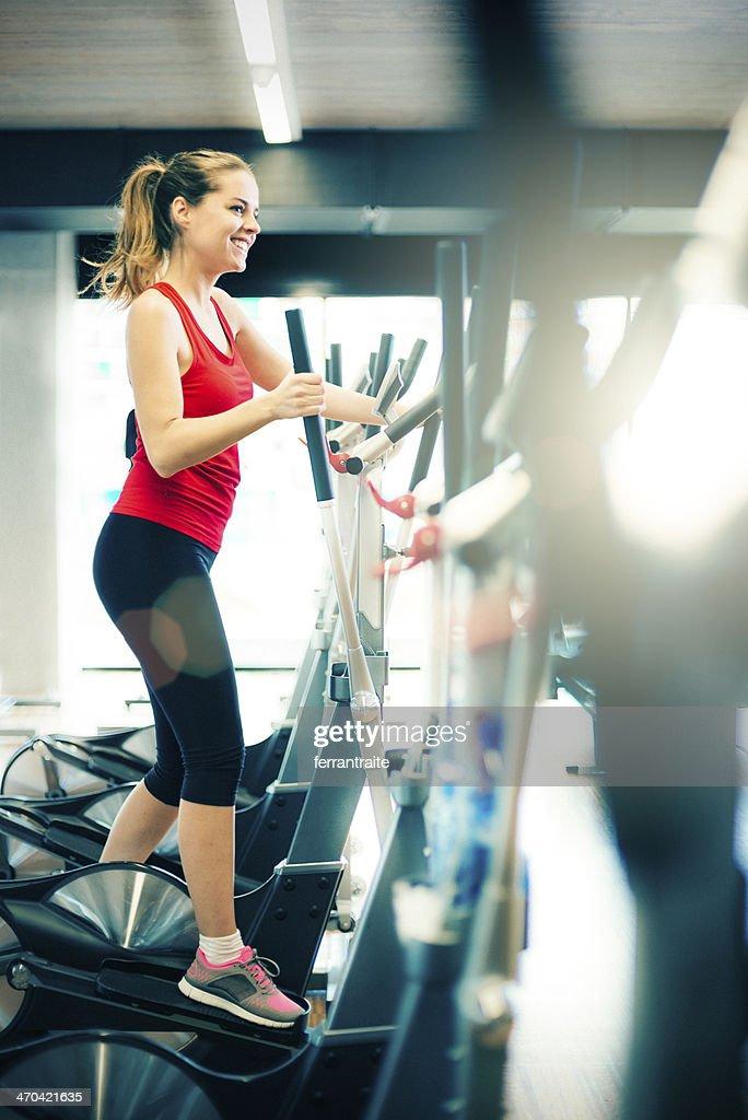 Healthy Woman on Elliptical Trainer