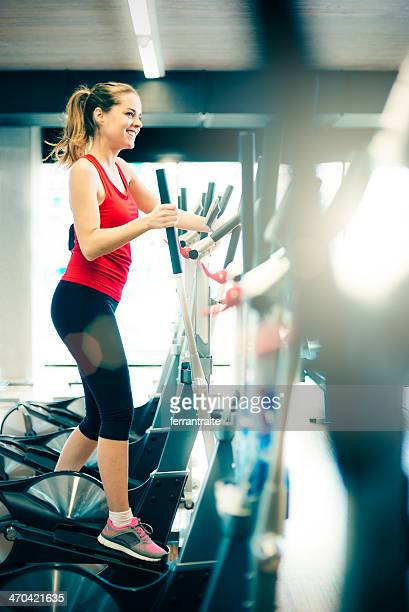 Healthy Woman on Elliptical Trainer