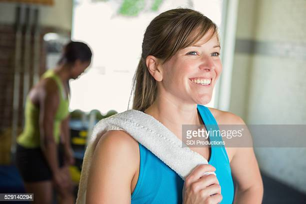 Healthy woman smiles after workout