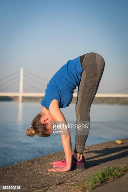 Healthy woman stretching after successful and efficient training