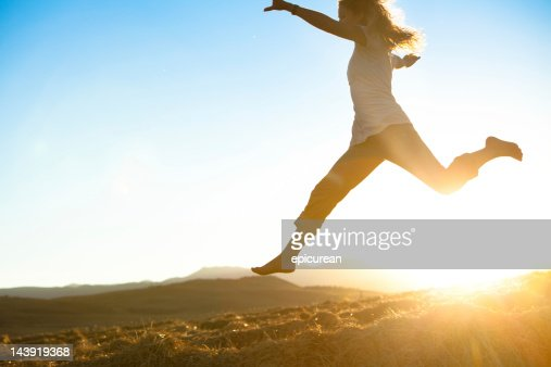 Healthy young beautiful woman running barefoot : Stock Photo
