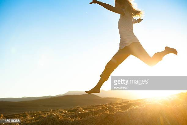 Healthy young beautiful woman running barefoot