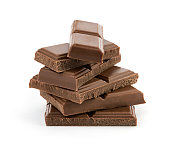 Heap of black chocolate bars on white background