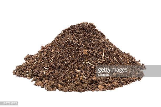 Heap of brown soil isolayed on white