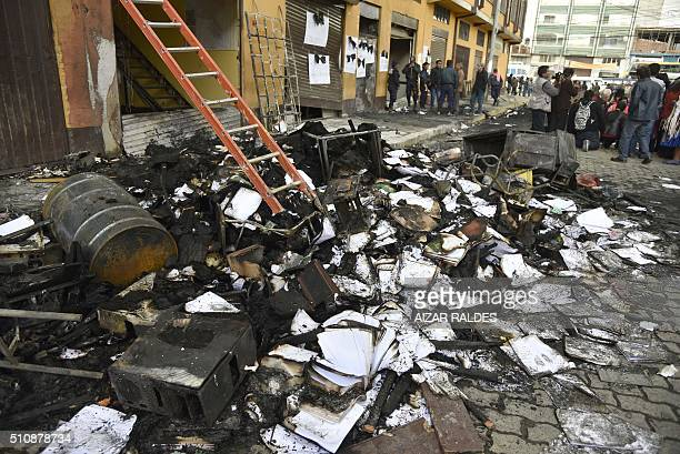 A heap of burnt out debris remain after angry demonstrators attacked the city hall of El Alto 12 km from La Paz on February 17 2016 Six people died...