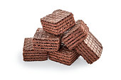 heap of chocolate square brownie wafer biscuits isolated on white backdrop. closeup view