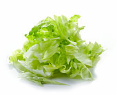 Heap of chopped iceberg lettuce isolated on white background
