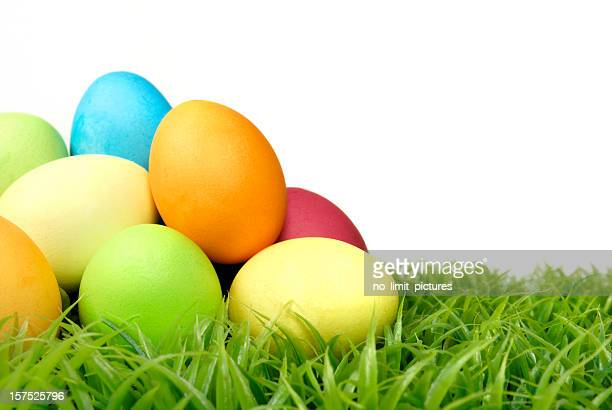 A heap of colored Easter eggs on the grass