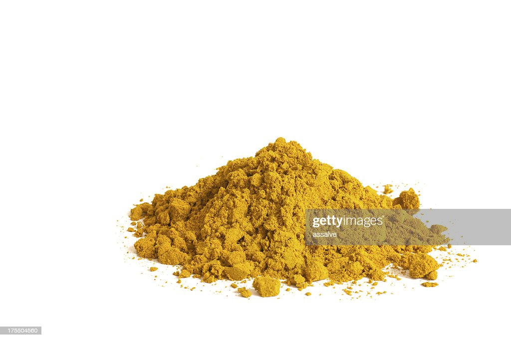 heap of curry powder on white background