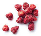 Heap of freeze dried strawberries isolated on white background. Top view