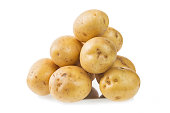 Heap of fresh young potatoes isolated on white background close up
