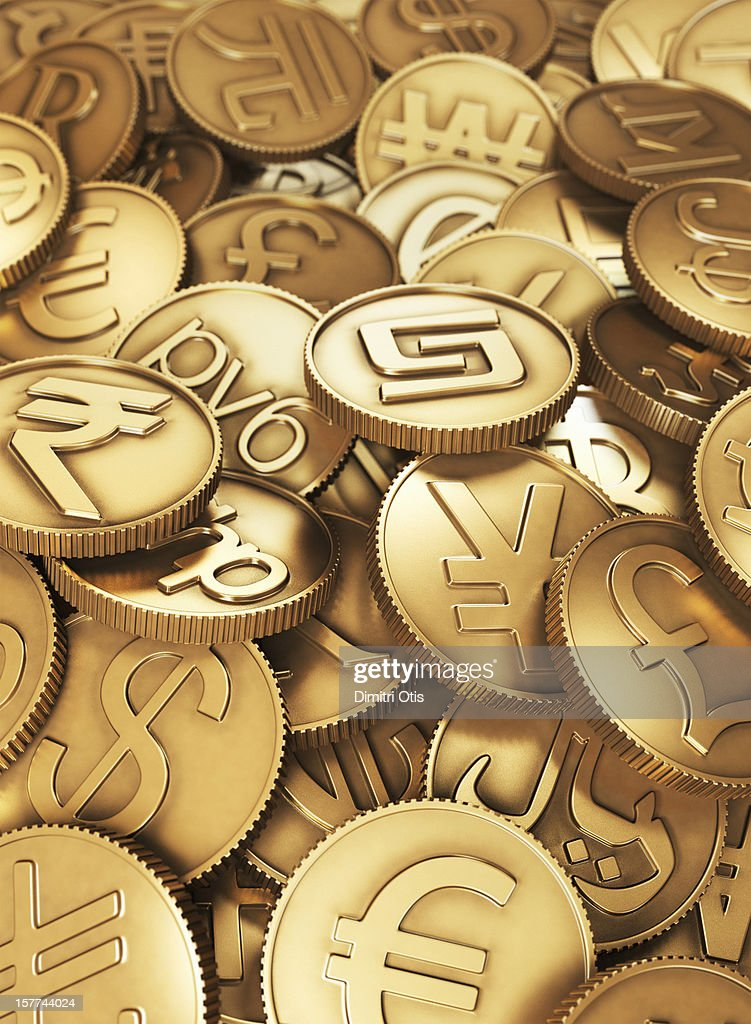 A heap of gold international currency coins : Stock Photo