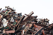 heap of metal scrap isolate on white background, waste automotive steel parts in junk yards.