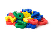 Heap of toy magnetic numbers isolated on white. More related images in Zocha`s objects