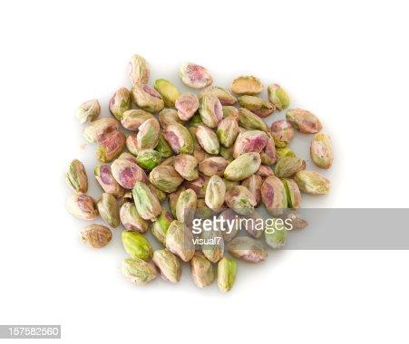 heap of peeled pistachios