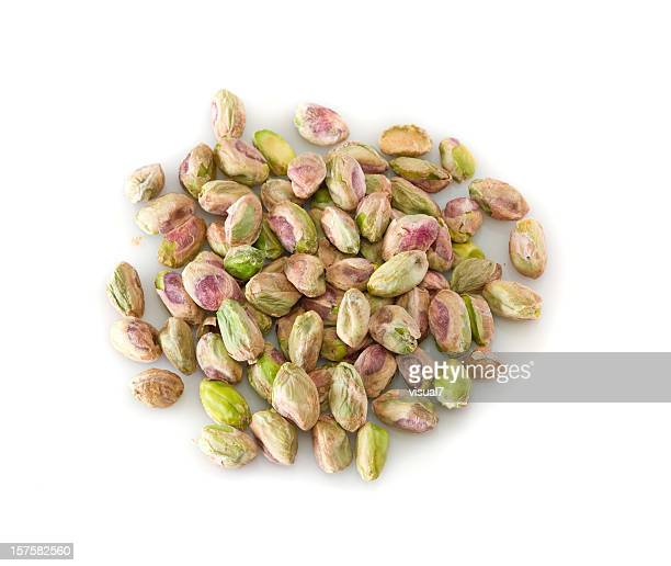 heap of peeled pistachios