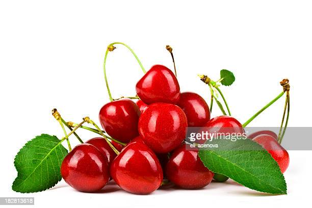 Heap of red cherries with leaves and stems