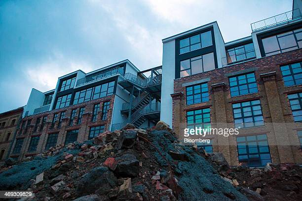 A heap of rubble sits outside the commercial property development known as The Factory a technology hotspot on Bernauer Strasse in Berlin Germany on...