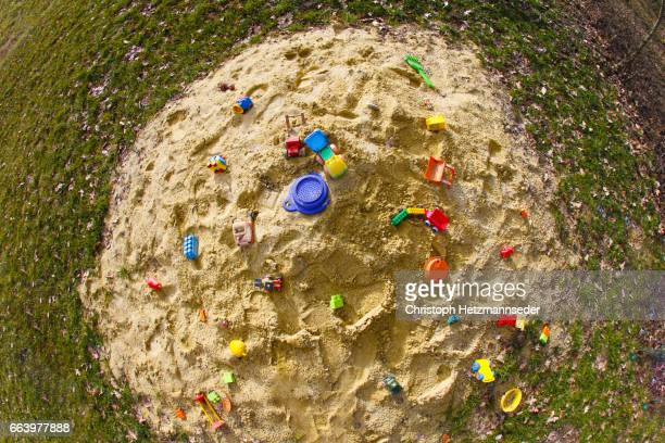 Heap of sand with toys