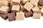 heap of square wafer biscuits isolated on white background. Top view