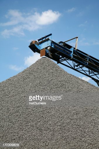 Heap of stones with conveyor belt