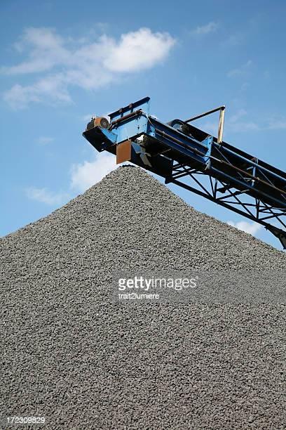 Heap of stones with conveyor belt