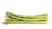 heap of uncooked green asparagus, isolated on white