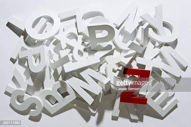 A heap of white block letters with a red letter Z