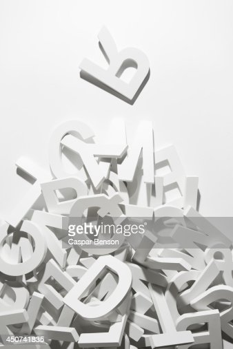 A heap of white block letters with the letter R placed above the pile