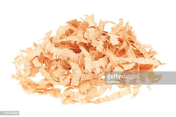 Heap of wood shavings isolated on white