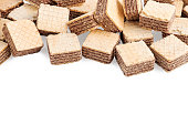 heap square wafer biscuits isolated on white background.