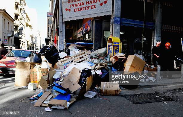 Heaped rubbish remains uncollected on October 12 2011 in Athens Greece Bin men have begun a strike with officials warning of a 'health time bomb' The...