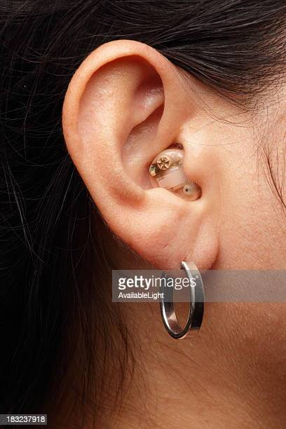 Hearing Aid in Woman's Ear