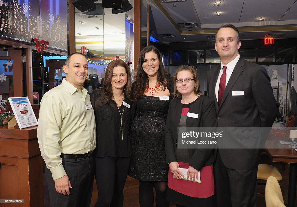 Hearing Health Foundation National Junior Board Members Jason Frank, his wife Jenny Frank, Kristie D'Agnes, Felicia Rovegno and Benjamin Melting attend the Hearing Health Foundation's Junior Board Holiday Fundraiser at Ashton's Alley on December 4, 2012 in New York City.