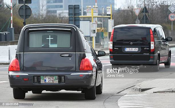 A hearse arrives to Brussels Airport in Zaventem following twin blasts on March 22 2016 A series of apparently coordinated explosions ripped through...