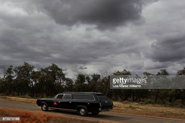 A hearse carrying the 40000 year old remains of Mungo Man and ancestors departs Balranald Aboriginal Cemetery on November 16 2017 in Balranald...