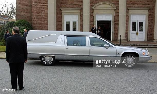 A hearse carrying the body of former Enron vicechairman J Clifford Baxter arrives at St Martin of Tours Church in Amityville NY 30 January 2002 for...
