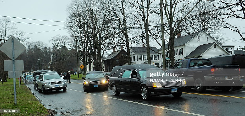A hearse carrying the body of Jack Pinto, 6, one of the victims of the Sandy Hook elementary school shooting, leaves Honan funeral home on its way to the cemetery, on December 17, 2012, in Newtown, Connecticut. Funerals began in the little Connecticut town of Newtown after the school massacre that took the lives of 20 small children and six staff, triggering new momentum for a change to America's gun culture. AFP PHOTO/Emmanuel DUNAND