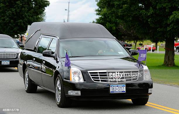 A hearse carrying the casket of Kevin Ward Jr drives away from South Lewis Senior High School following a funeral service on August 14 2014 in Turin...