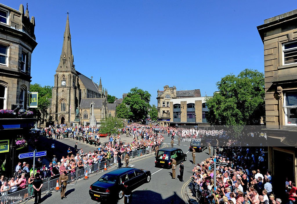 A hearse carrying the coffin of Fusilier Lee Rigby's arrives at Bury Parish Church for an overnight vigil on July 11 2013 in Bury England The Royal...