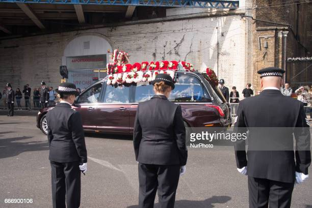 A hearse carrying the coffin of PC Keith Palmer makes its way down Southwark Street past lines of police officers after his funeral at Southwark...