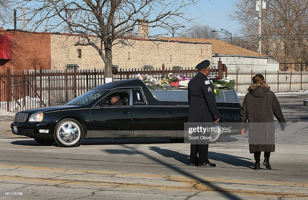 A hearse carrying the remains of 15-year-old Hadiya Pendleton leaves the Greater Harvest M.B. Church following her funeral on February 9, 2013, in Chicago, Illinois. Hadiya was killed on January 29, when a gunman opened fire on her and some friends while they were standing under a shelter on a warm rainy afternoon in a park about a mile from President Obama's Chicago home. First lady Michelle Obama attended the funeral with Senior White House Adviser Valerie Jarrett and Secretary of Education Arne Duncan.