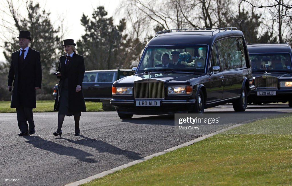 A hearse carrying the two coffins containing the body of Ross Simons and his wife Clare arrives at Westerleigh Crematorium for their joint funeral on February 15, 2013 in Bristol, England. The couple were killed when their tandem bike collided with a car in Hanham. A 38-year-old man has been charged with two counts of causing death by dangerous driving after Ross Simons, 34, and Clare, 30, died at the scene of the crash in Bristol on January 27, 2013.