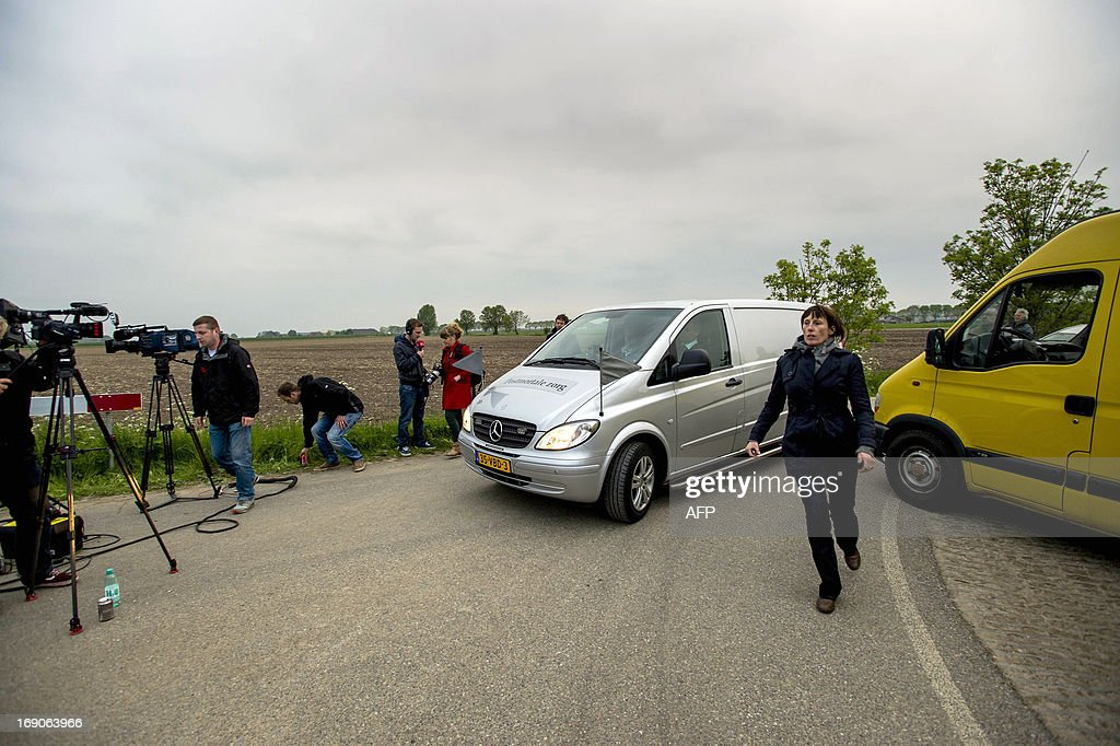 A hearse leaves the area near Cothen, on May 19, 2013, where two bodies were found earlier today. The location is close to the place where the father of the two missing brothers Julian and Rubin was found dead on May 7, 2013 after commiting suicide. AFP PHOTO / ANP / ROBIN VAN LONKHUIJSEN