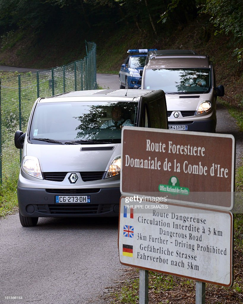 Hearses leave with the bodies, on the 'Combe d'Ire' road in the French Alpine village of Chevaline on September 6, 2012, where four people were shot dead. A four-year-old girl spent hours curled up under her mother's body and miraculously survived the deadly attack that left her father, mother and grandmother dead and her elder sister seriously injured, officials said.