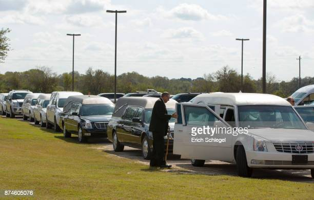 Hearses line up for the memorial service held at the Floresville Events Center on November 15 2017 in Floresville Texas for the nine members of the...