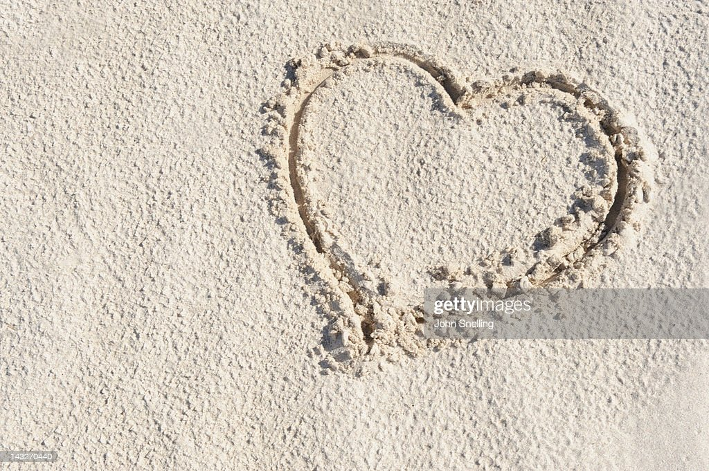 Heart and love in sand : Stock Photo