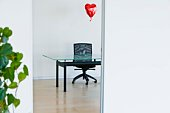 Heart balloon in an office
