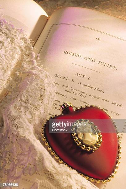 Heart cameo with lace and script for Romeo and Juliet